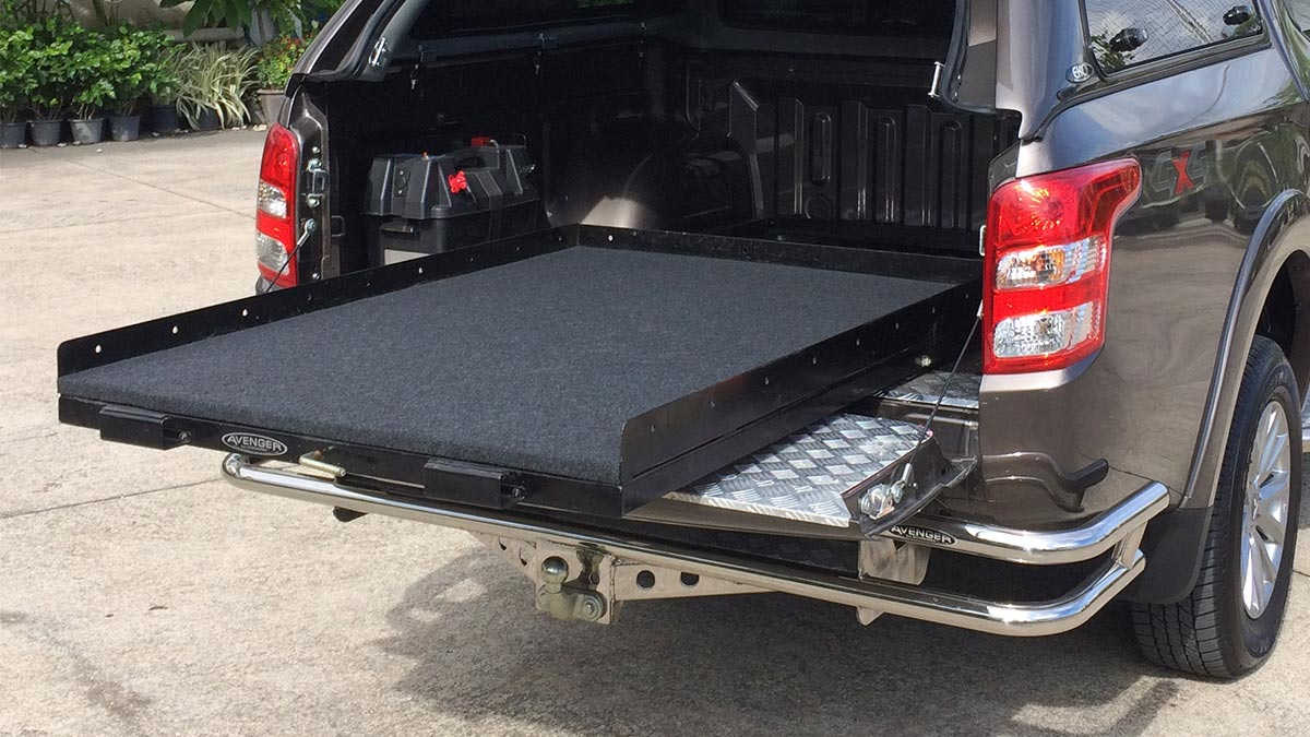 Tray slide flat bed on Nissan Navara with EKO Canopy and dark Brown Colour