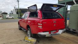triton-mq-2015-with-canopy-in-r59-red