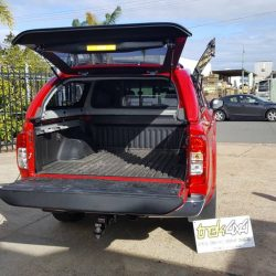 nissan-navara-2015-canopy-open-tailgate-in-ax6red